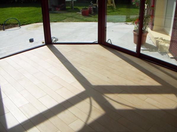 carrelage imitation parquet bois pour l 39 int rieur d 39 une v randa blog de normandie construction. Black Bedroom Furniture Sets. Home Design Ideas