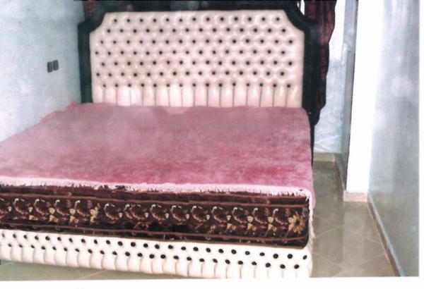 T�te de lit en semi cuir