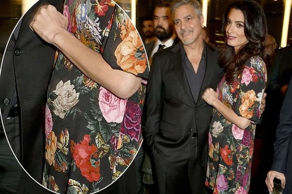 Amal Clooney shows off fuller figure in gorgeous floral dress