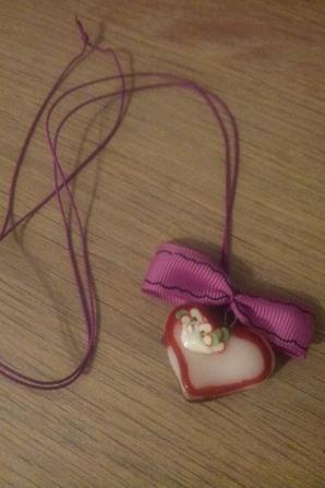 collier coeur et gâteau arc en ciel