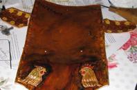 Pochette cuir style vielli.