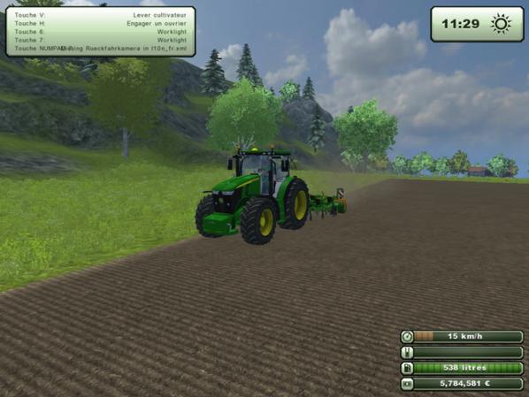 passage du cultivateur avec le tracteur en demonstration