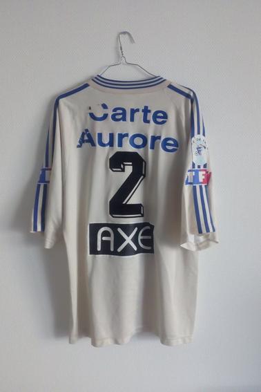 Maillot Olympique Lyonnais porté par C. Delmotte lors des 1/4 de finale de coupe de France face à Bourg Peronnas durant la saison 97/98