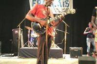 Patrick Buluku Dans la scène en Flamme