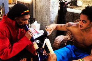 ( Photos) Snoop Dogg: Il fume de l'herbe avec son fils