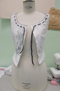 Cache corset du XIV