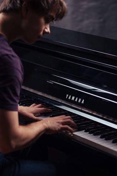 Alex playing Piano