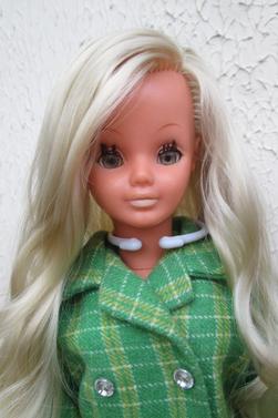 3 têtes différentes pour une même poupée