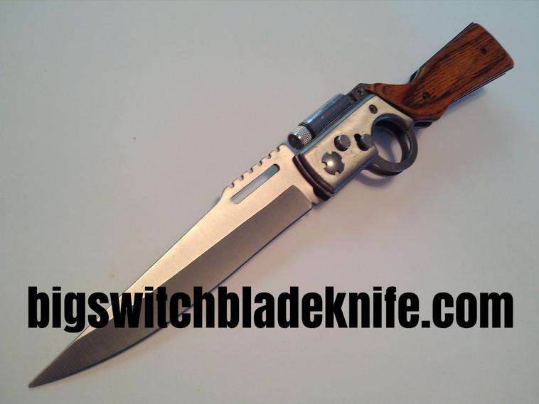 Switchblade - 10 inch Rifle style switchblade automatic knife with Built in LED flashlight. $59.95