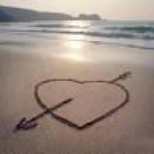 oh! un couer sur le sable de plage..
