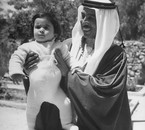 Crown prince Talal holding his son, prince Hassan