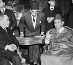 King Mohammed V with his Prime Minister and his son