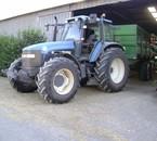 New Holland TM150 et benne Coutand 14 tonnes au blé