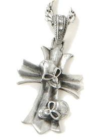 collier métal et strass croix et 2 crânes