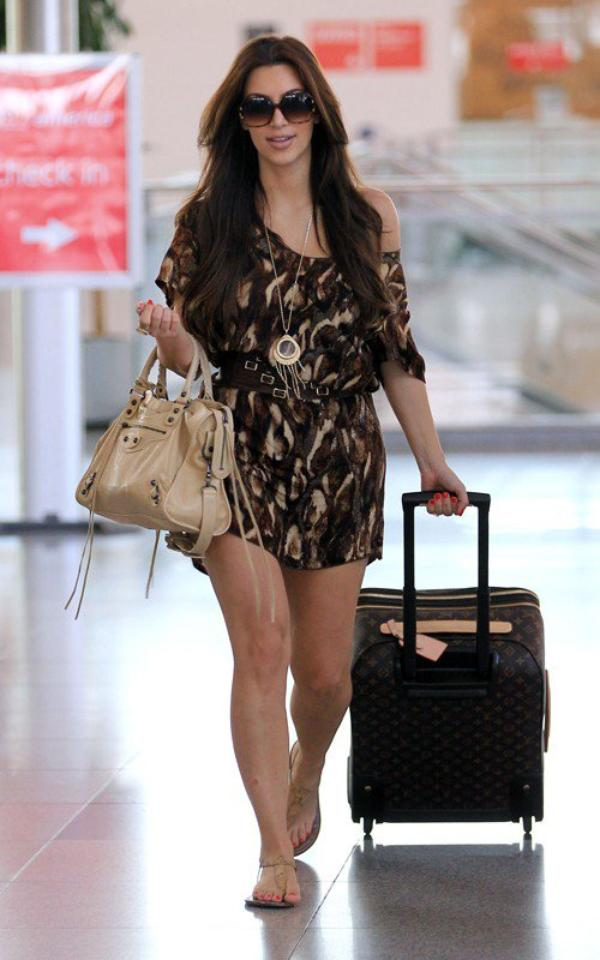 Kim arriving at JFK airport in NYC (07/18)