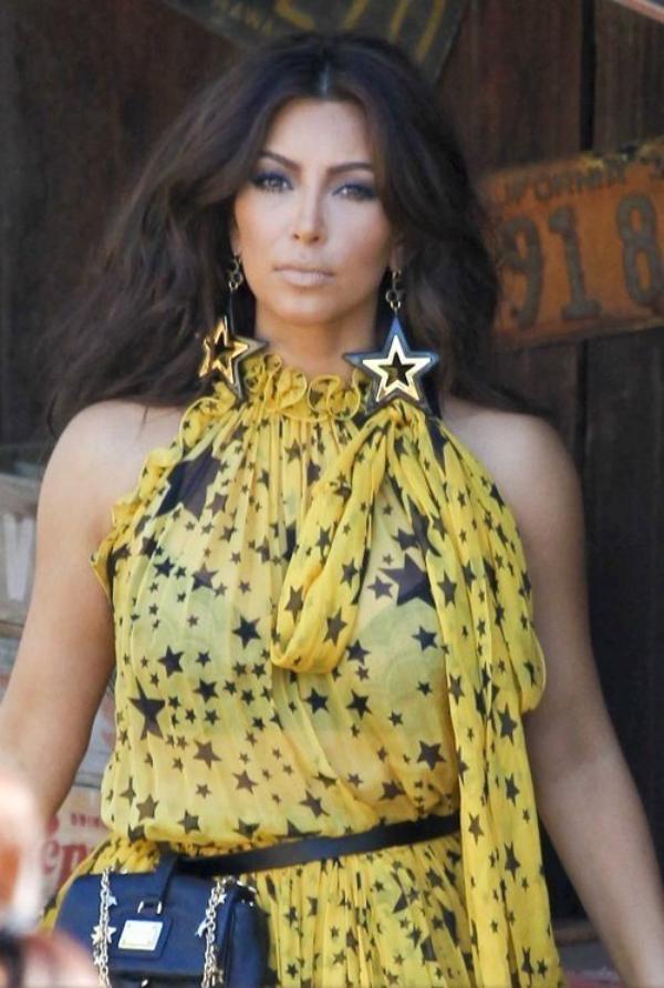 Kim at a magazine photo shoot in Malibu (07/27)