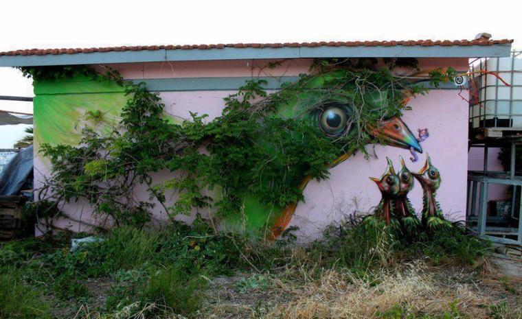 maman oiseau en mur vegetal
