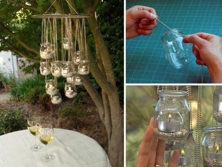 photophores avec des pots en verre suspendu dans un arbre