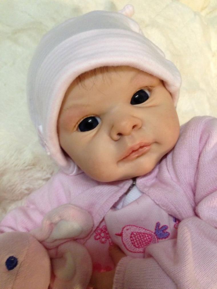 Très jolie bébé Mélanie de 2,000kg a été adopté par Annick