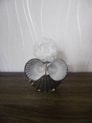 Un ange avec des coquillages