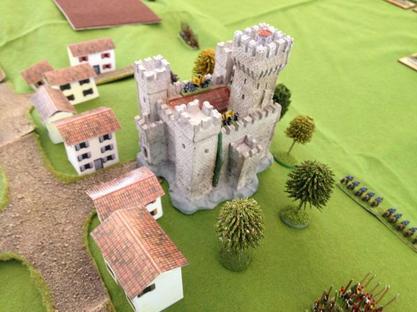 Un village, un chateau sur les hauteurs occupés par les Espagnols