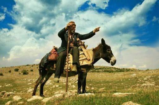 Le fermier, son fils et leur âne