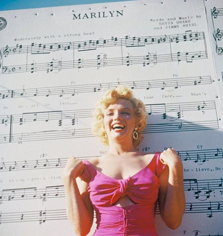 """1952 """"The Ray ANTHONY party"""" (part 6) PAROLES de la chanson """"Marilyn"""" by Ray ANTHONY / An angel in lace, A fabulous face, That's no exggeration, That's my Marilyn.  No gal, I believe, Beginning with Eve, Could weave a fascination like my Marilyn.  She made me a poet, Thinking up romantic themes, Though she may not know it, she's all mine in my dreams !  I've planned everything, The church and the ring, The one who doesn't know it yet Is Marilyn.  She hasn't said """"Yes"""" I have to confess : I haven't kissed, or even met My Marilyn.  But if luck is with me She'll be my bride forevermore ; I'll be marryin', carryin' Marilyn through my door ! ! !"""