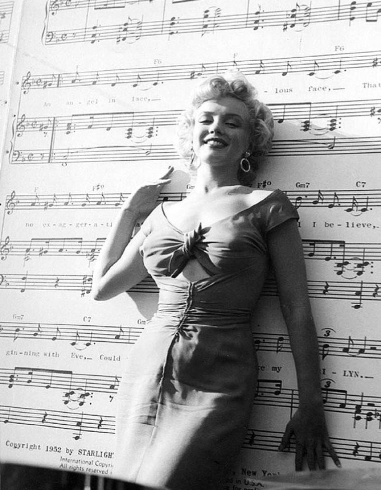 "1952 ""The Ray ANTHONY party"" (part 6) PAROLES de la chanson ""Marilyn"" by Ray ANTHONY / An angel in lace, A fabulous face, That's no exggeration, That's my Marilyn.  No gal, I believe, Beginning with Eve, Could weave a fascination like my Marilyn.  She made me a poet, Thinking up romantic themes, Though she may not know it, she's all mine in my dreams !  I've planned everything, The church and the ring, The one who doesn't know it yet Is Marilyn.  She hasn't said ""Yes"" I have to confess : I haven't kissed, or even met My Marilyn.  But if luck is with me She'll be my bride forevermore ; I'll be marryin', carryin' Marilyn through my door ! ! !"