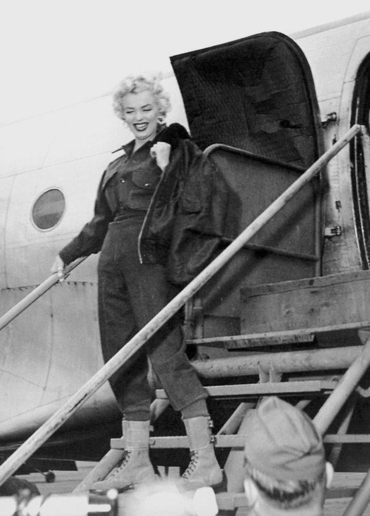 Il existe plusieurs versions sur les raisons qui auraient poussé Marilyn à partir se produire en Corée, pour chanter et rencontrer les soldats américains postés là-bas. Marilyn avait parlé d'un marine, plusieurs semaines avant de s'envoler pour l'Asie. Elle aurait raconté à ses proches qu'un soldat, fraîchement revenu de Corée, était venu la voir chez elle pour lui dire combien le cinéma comptait pour les hommes en service là-bas. Marilyn aurait été touchée par le témoignage de ce soldat, qui s'était mis à pleurer devant elle. Selon Sydney SKOLSKY, Marilyn avait donc déjà formé le projet de cette visite bien avant de partir pour le Japon. Bien que Joe DiMAGGIO aurait désapprouvé, Marilyn n'avait pas tenu compte de son avis. Marilyn aurait ainsi affirmé à son agent Charles FELDMAN, son désir d'aller en Corée. Et pour Charles FELDMAN, cette tournée en Corée représentait un gros avantage. Marilyn venant d'être suspendue par la Fox pour avoir refusé de tourner un film, son agent pouvait d'une part, commencer les négociations avec ZANUCK sans les contestations de Marilyn pendant son absence. Et d'autre part, l'idée de faire une tournée en Corée fut suggérée, pour remonter le moral des GI's postés là-bas, bien que la guerre était finie depuis plus de six mois. Ainsi, selon FELDMAN, cette tournée serait donc une formidable publicité pour l'image médiatique de Marilyn. Et la Fox aurait ainsi eu du mal à attaquer Marilyn dans la presse, au moment où elle se produisait sur scène, chantant et dansant pour les soldats. D'après Marilyn, c'est un général présent lors du vol du couple entre Hawaï et Tokyo, qui lui suggéra cette idée. Et Joe  n'aurait fait aucune objection. C'est pendant que le couple visitait le Japon, qu'un officier de l'armée américaine suggéra l'idée que, pour le moral des troupes, Marilyn aille divertir les soldats engagés en Corée. Comme Joe avait un agenda plutôt chargé et que Marilyn s'ennuyait ferme, elle y consentit en dépit des objections de son mari.