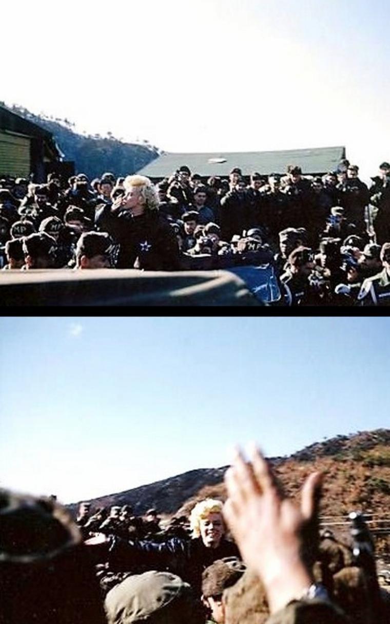 """A son arrivée à la Seoul City Airbase, où est postée la base K16, Marilyn reçoit un acceuil triomphant : quelques journalistes, vidéastes et photographes sont présents, mais surtout, des centaines de soldats et officiers l'acclamèrent. Toujours vêtue d'une tenue de l'armée de couleur kaki, Marilyn a ôté le blouson, qu'elle porte à l'épaule et n'a plus de foulard sur la tête. Elle sourit sans cesse et se prête au jeu des salutations et des poses photos.  Après avoir discuté avec quelques soldats et répondu à des interviews, en posant devant les caméras présentes, elle visite rapidement la base. Puis elle est ensuite transférée par hélicoptère qui l'emmène à travers le froid et les montagnes, où la """"First Marine Division"""" est postée. Elle demande au pilote de voler au-dessus de la base, où l'attendent des milliers de soldats. Arrivée à la base, après sa descente d'hélicoptère, elle discute avec des officiers et pose en photo avec eux."""