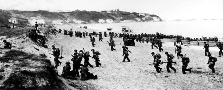 File source: http://commons.wikimedia.org/wiki/File:Torch-troops_hit_the_beaches.jpg