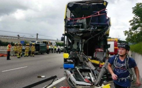 01-07-2013 - Hong Kong - The front of the bus was torn open, spraying passengers with glass from the windscreen. The three vehicles were all on their way to the airport