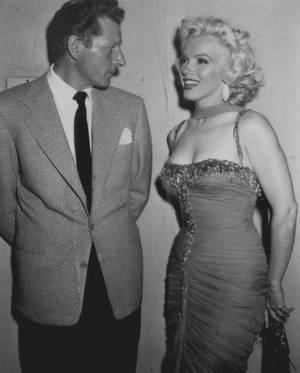 """1953 / by Bruno BERNARD... Marilyn participe à une action caritative au """"Hollywood Bowl"""" le 10 juillet 1953 dont les bénéfices seront reversés à l'hôpital """"Saint Jude"""". Pour cette soirée, Marilyn porte une de ses tenues du film """"Les Hommes préfèrent les blondes"""" (une longue robe aux tons rouge-orangé avec le petit foulard assorti). Marilyn est accompagnée de l'acteur Robert MITCHUM (son partenaire dans """"La Rivière Sans Retour"""") ; ensuite elle retrouve l'acteur de sitcom Danny THOMAS sur scène pour co-animer la soirée, puis elle pose pour les photographes (dont Bruno BERNARD, photo) dans les coulisses aux côtés du chanteur et acteur Danny KAYE, l'acteur Red BUTTONS, Jane RUSSELL et le quatuor de chanteurs les """"Ames Brothers"""", entre autres..."""