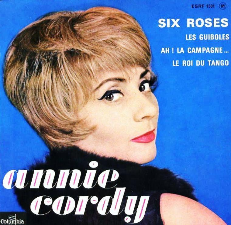 """Annie CORDY, de son vrai nom Léonia COOREMAN, est une chanteuse et actrice belge, née à Laeken (Bruxelles) le 16 juin 1928. Elle a un frère, Louis, et une s½ur, Jeanne. Son père s'appelait Jan Cornelius COOREMAN et sa mère Maria De LEEUW. (photos extraites notamment du film """"Le chanteur de Mexico"""" en 1956 de Francis LOPEZ avec Bourvil et Luis MARIANO entre autres)."""
