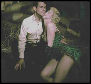 "1956 / Marilyn et Don MURRAY sur le tournage du film ""Bus stop"", Marilyn campant Chérie, une danseuse de saloon, chantant ""That old black magic"" dans un costume signé TRAVILLA sous l'objectif du photographe Milton GREENE."
