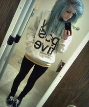 Les cheveux bleu-vert, turquoise