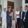 Mr Abdelkader Bendamèche visitant l'exposition photos et livres à ses côtés l'écrivain Mohamed Boudia au Musée de Chlef le 19 Mai 2010