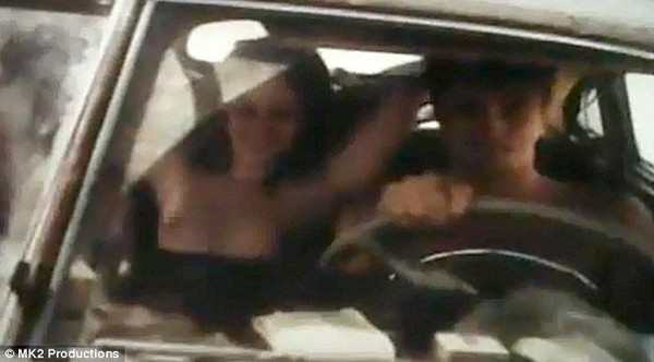She's certainly not shy! Kristen Stewart flashes a sexy smile as she goes completely nude for racy On The Road scene