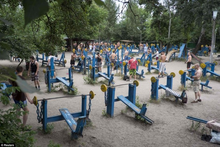 Ukraine's answer to Muscle Beach! Kiev weightlifters at the world's only scrapyard gym show how to really pump iron