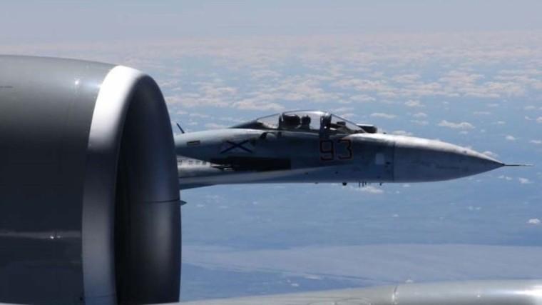 Photos show Russian jet buzzing spy plane