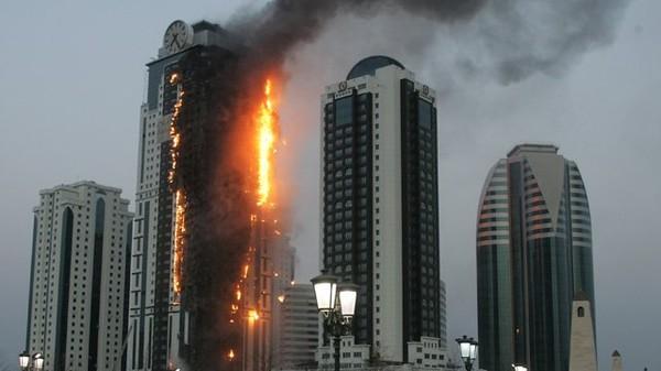 Les Chroniques De Rorschach: Grozny : Un gratte ciel prend feu mais ne s'écroule pas